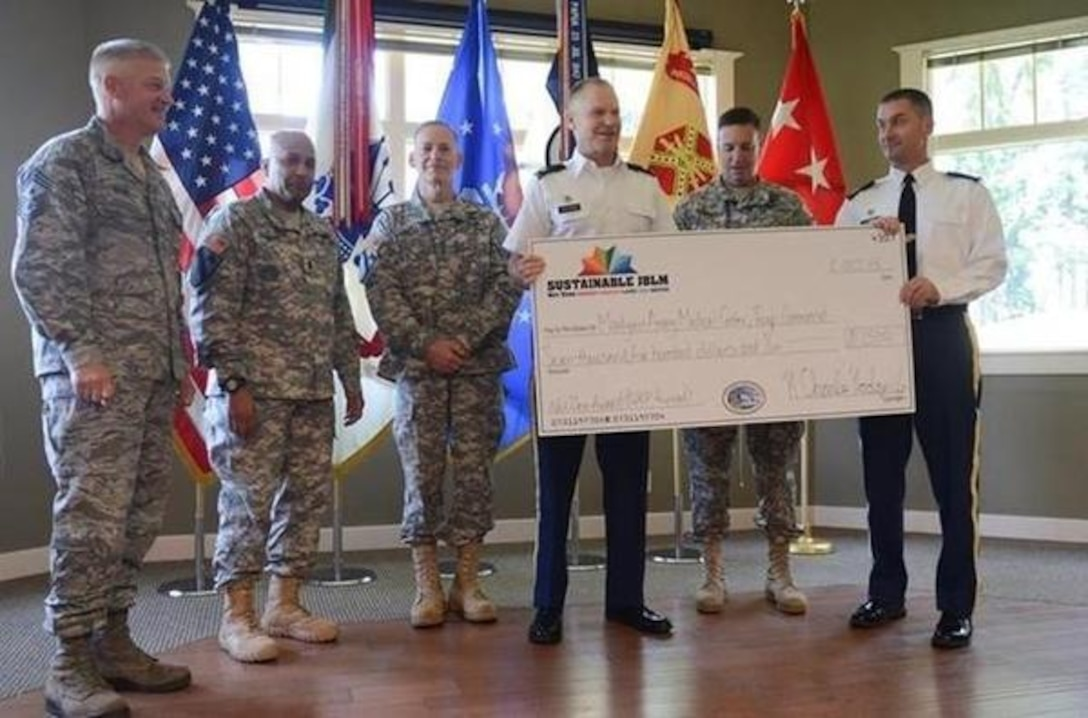 Service members, civilians and Net Zero winners receive awards during a recent quarterly ceremony at Eagles Pride Golf Course. (Norhtwest Guardian/courtesy photo)