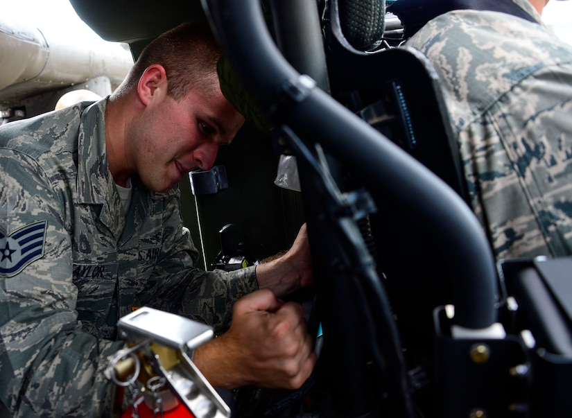 U.S. Air Force Staff Sgt. Samuel Taylor, 612th Air Base Squadron firefighter, tries to remove the pilot seat from UH-60 Blackhawk helicopter during aircraft crash rescue training with the 1-228th Aviation Regiment at Soto Cano Air Base, Honduras, Jan. 15, 2015.  At least once a quarter, the 612th ABS teams up with the 1-228th Avn. Reg. to review aircraft crash rescue training and emergency procedures for the UH-60 Blackhawk helicopter. (U.S. Air Force photo/Tech. Sgt. Heather Redman)