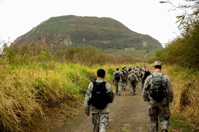 Airmen from Kadena Air Base, Japan, hike toward Mount Suribachi on Iwo To, Japan Jan. 8, 2015. They visited Iwo To as part of a professional military education outing to learn about the battle of Iwo Jima that took place nearly 70 years ago. (U.S. Air Force photo by Airman 1st Class John Linzmeier)