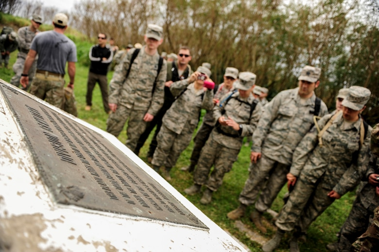 Airmen from Kadena Air Base, Japan, gather around a World War II memorial on Iwo To, Japan Jan. 8, 2015. They visited the island for a day to see the battleground, once known as Iwo Jima, of the largest assault in U.S. Marine Corps history. More than 6,800 Marines died over a period of 36 days. (U.S. Air Force photo by Airman 1st Class John Linzmeier)