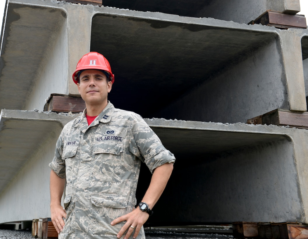 Capt. Nassem Ghandour poses beside double-tee beams Jan. 16, 2015, in Yigo, Guam. Ghandour was recognized through the Every Dollar Counts program after he saved the Air Force more than $235,000. Ghandour is the 554th RED HORSE Squadron Engineering Flight deputy commander. (U.S. Air Force photo/Staff Sgt. Robert Hicks)