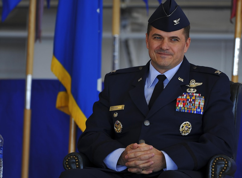 Col. Sean Farrell, 1st Special Operations Wing commander, assumes command during the 1st Special Operations Wing change of command ceremony at the Freedom Hangar on Hurlburt Field, Fla., Jan. 6, 2015. The primary mission of the 1st SOW is to rapidly plan and execute specialized and contingency operations in support of national priorities. (U.S. Air Force photo/Senior Airman Christopher Callaway)