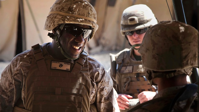 In this 2013 image, Sgt. Maj. Ronald L. Green, then serving as the sergeant major of 1st Marine Expeditionary Force, speaks with Marines participating in Exercise Desert Scimitar during a battlefield circulation aboard Marine Corps Air Ground Combat Center Twentynine Palms, California, May 3, 2013. (U.S. Marine Corps photo by Lance Cpl. Ismael E. Ortega/Released)