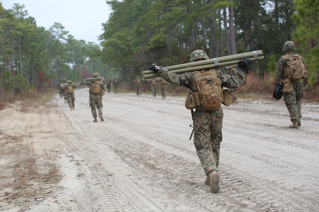 Marines with Engineer Platoon, Headquarters and Service Company, Ground Combat Element Integrated Task Force, conduct a patrol during a field training exercise at Engineer Training Area 2 aboard Marine Corps Base Camp Lejeune, North Carolina, Jan. 16, 2015. From October 2014 to July 2015, the GCEITF will conduct individual and collective level skills training in designated ground combat arms occupational specialties in order to facilitate the standards based assessment of the physical performance of Marines in a simulated operating environment performing specific ground combat arms tasks. (U.S. Marine Corps photo by Cpl. Paul S. Martinez/Released)