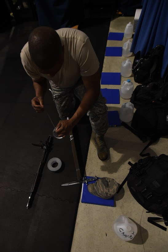 Tech. Sgt. Maurice Chaney, United States Air Force honor guardsman, dissembles and duct-tapes his M1 Garand with a fixed bayonet during USAFHG Drill Team Training at Joint Base Anacostia-Bolling, Md., Jan. 13, 2015. The trainees secure their weapon before every class to keep weapons from dismantling when dropped.  (U.S. Air Force photo/ Senior Airman Nesha Humes)