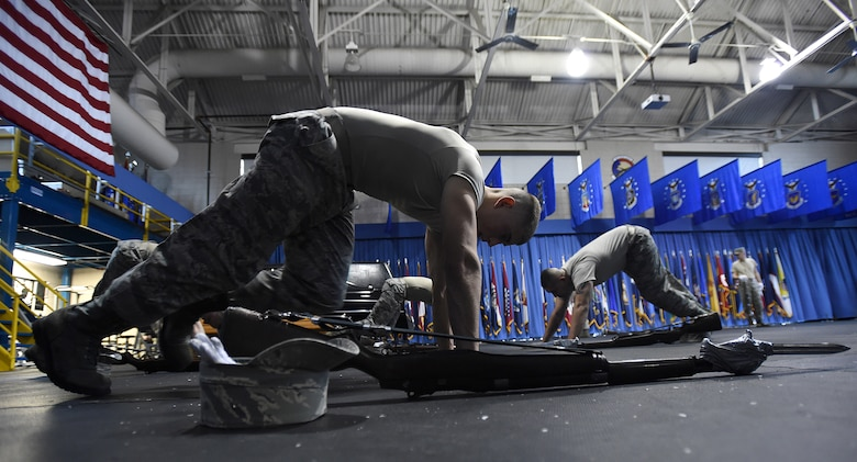 Trainees perform mountain climbers during United States Air Force Honor Guard Drill Team Training at Joint Base Anacostia-Bolling, Md., Jan. 13, 2015. Six trainees volunteer eight, 60-hour weeks to learn to learn weapon maneuvers and calisthenics to gain a spot on the team. (U.S. Air Force photo/ Senior Airman Nesha Humes)