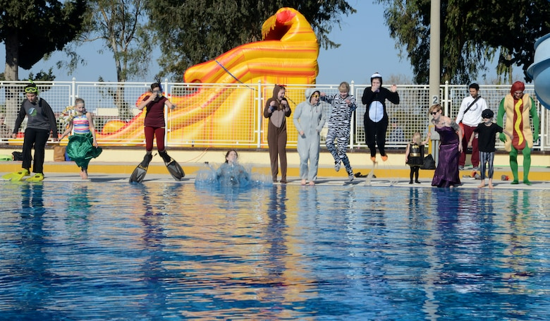 Members of Incirlik Air Base jump into the pool at the 2015 Polar Plunge Jan. 17, 2015, at Incirlik Air Base, Turkey. Many of the members quickly climbed out because of the freezing temperature, while a couple members continued to swim. (U.S. Air Force photo by Staff Sgt. Caleb Pierce/Released)