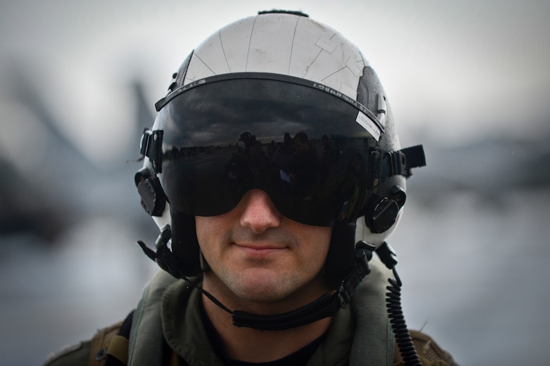 A Navy pilot with the VFA-106 is interviewed from local media agencies after a training flight in the F-18 Superhornet at MacDill Air Force Base, Fla., Jan. 9, 2015. More than 180 personnel from Oceana Naval Air Station, Va., came to MacDill for a Navy Training Exercise. (U.S. Air Force photo by Senior Airman Ned T. Johnston/Released)