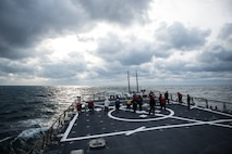 Sailors aboard USS Donald Cook (DDG 75) conduct a foreign object damage (FOD) walk-down on the flight deck as part of a crash-and-salvage drill Jan 6, 2015. Donald Cook, an Arleigh Burke-class guided-missile destroyer, forward-deployed to Rota, Spain, is conducting naval operations in the U.S. 6th Fleet area of operations in support of U.S. national security interests in Europe. (U.S. Navy photo by Mass Communication Specialist 2nd Class Karolina A. Oseguera/Released)