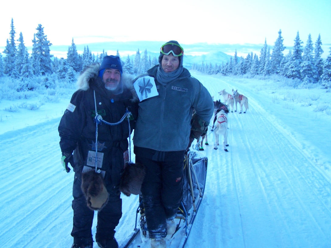 Scott Janssen  and Maj. Roger Lee pose for a photo while training to participate in the Trail Sled Dog Race in Alaska. Janssen befriended Lee and serves as his mentor. Lee is a 60th Aerospace Medicine Squadron bioenvironmental engineering operations officer. (Courtesy photo)