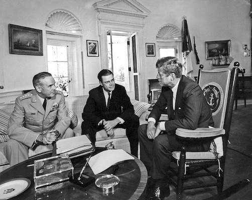 AR8153-A  02 October 1963  President Kennedy meets with the Secretary of Defense and Chairman of the Joint Chiefs of Staff. General Maxwell D. Taylor, Secretary Robert S. McNamara, President Kennedy. White House, Oval Office. Photograph by Abbie Rowe, National Park Service, in the John F. Kennedy Presidential Library and Museum.