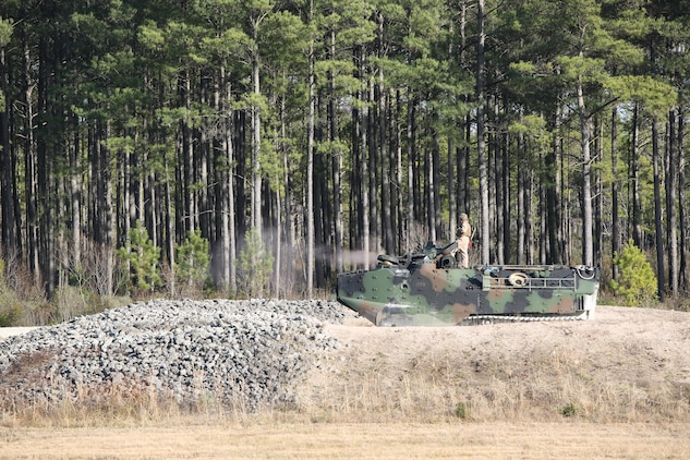 Marines with Amphibious Assault Vehicle Platoon, Company B, Ground Combat Element Integrated Task Force, assault targets downrange during a live-fire exercise at Range SR-10 aboard Marine Corps Base Camp Lejeune, North Carolina, Jan. 20, 2015. From October 2014 to July 2015, the GCEITF will conduct individual and collective level skills training in designated ground combat arms occupational specialties in order to facilitate the standards based assessment of the physical performance of Marines in a simulated operating environment performing specific ground combat arms tasks. (U.S. Marine Corps photo by Cpl. Paul S. Martinez/Released)