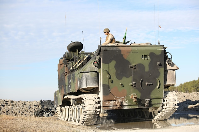 Staff Sgt. Charles L. Burger, section leader, Amphibious Assault Vehicle Platoon, Company B, Ground Combat Element Integrated Task Force, sits atop an AAV during a live-fire exercise at Range SR-10 aboard Marine Corps Base Camp Lejeune, North Carolina, Jan. 20, 2015. From October 2014 to July 2015, the GCEITF will conduct individual and collective level skills training in designated ground combat arms occupational specialties in order to facilitate the standards based assessment of the physical performance of Marines in a simulated operating environment performing specific ground combat arms tasks. (U.S. Marine Corps photo by Cpl. Paul S. Martinez/Released)