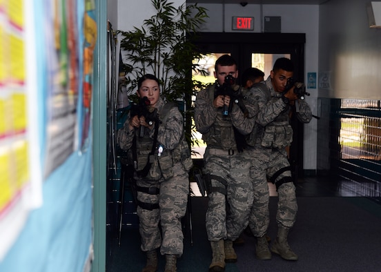 36th Security Forces Squadron Airmen practice scenarios during active shooter training at Andersen Elementary School Jan. 18, 2015, at Andersen Air Force Base, Guam. The training is designed to familiarize SFS Airmen with the school and to fine -tune their tactics in the event a real situation occurs.(U.S. Air Force photo by Senior Airman Cierra Presentado/Released)