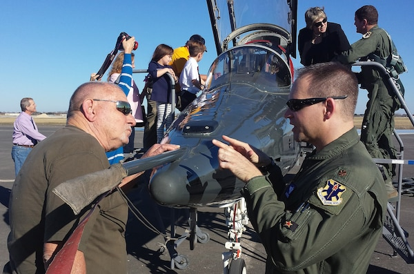 Maj. Robert Lee, 12th Operations Support Squadron, gives a tour of a T-38C Talon to retired Seguin Firefighter Elroy Hoffer during symbolic ribbon cutting event at Joint Base San Antonio-Randolph Seguin Auxiliary Airfield Jan. 20. The event signified the reopening of the airfield following a $12.4 million repaving and construction project that included replacing and grading the entire airfield, stabilizing existing soils, and constructing a new taxiway, parking apron and emergency access road.  (U.S. Air Force photo by Johnny Saldivar)