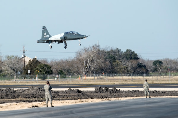 """The first T-38C Talon lands at the Joint Base San Antonio-Randolph Seguin Auxiliary Airfield during a ribbon cutting event signifying the reopening of the JBSA-Randolph Seguin Auxiliary Airfield Jan. 20.  Upon completion of a three-year construction project, the airfield is now ready for flying by members of the 560th Flying Training Squadron.  The airfield is crucial for """"touch and go"""" training that qualifies fighter and bomber pilots as instructor pilots in the T-38C Talon.  The reconstructed runway increases flight safety by distributing training around the San Antonio area, which means fewer aircraft and less congestion around Joint Base San Antonio-Randolph. (U.S. Air Force photo by Johnny Saldivar)"""