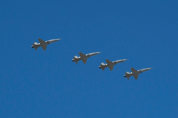 """A formation of T-38C Talons flies over Joint Base San Antonio-Randolph Seguin Auxiliary Airfield during a ribbon cutting event signifying the reopening of the JBSA-Randolph Seguin Auxiliary Airfield Jan. 20.  Upon completion of a three-year construction project, the airfield is now ready for flying by members of the 560th Flying Training Squadron.  The airfield is crucial for """"touch and go"""" training that qualifies fighter and bomber pilots as instructor pilots in the T-38C Talon.  The reconstructed runway increases flight safety by distributing training around the San Antonio area, which means fewer aircraft and less congestion around Joint Base San Antonio-Randolph. (U.S. Air Force photo by Johnny Saldivar)"""