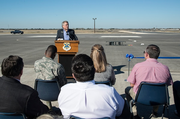 City of Seguin Mayor Don Keil, addresses the crowd during a symbolic ribbon cutting event at Joint Base San Antonio-Randolph Seguin Auxiliary Airfield Jan. 20. The event signified the reopening of the airfield following a $12.4 million repaving and construction project that included replacing and grading the entire airfield, stabilizing existing soils, and constructing a new taxiway, parking apron and emergency access road.  (U.S. Air Force photo by Johnny Saldivar)