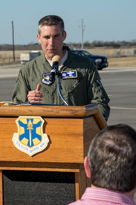 Col. Matt Isler, 12th Flying Training Wing commander, addresses the crowd during the symbolic ribbon cutting event at Joint Base San Antonio-Randolph Seguin Auxiliary Airfield Jan. 20. The event signified the reopening of the airfield following a $12.4 million repaving and construction project that included replacing and grading the entire airfield, stabilizing existing soils, and constructing a new taxiway, parking apron and emergency access road.  (U.S. Air Force photo by Johnny Saldivar)