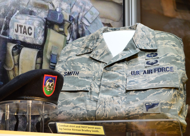 "DAYTON, Ohio -- The ""Duty First, Always Ready"" exhibit, located in the Cold War Gallery at the National Museum of the U.S. Air Force, highlights the service of Senior Airmen Michael Malarsie and Bradley Smith, a two-man Joint Terminal Attack Controller (JTAC) who deployed together to Afghanistan in December 2009. Here is a TACP beret and ABU blouse worn by Smith. (U.S. Air Force photo)"