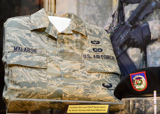 "DAYTON, Ohio -- The ""Duty First, Always Ready"" exhibit, located in the Cold War Gallery at the National Museum of the U.S. Air Force, highlights the service of Senior Airmen Michael Malarsie and Bradley Smith, a two-man Joint Terminal Attack Controller (JTAC) who deployed together to Afghanistan in December 2009. Here is a TACP beret and ABU blouse worn by Malarsie. (U.S. Air Force photo)"