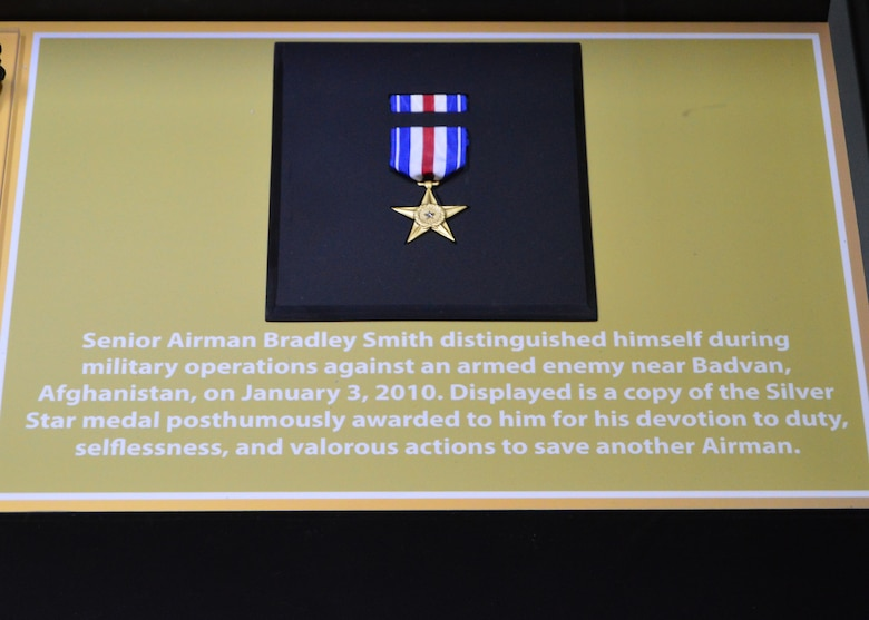 "DAYTON, Ohio -- The ""Duty First, Always Ready"" exhibit, located in the Cold War Gallery at the National Museum of the U.S. Air Force, highlights the service of Senior Airmen Michael Malarsie and Bradley Smith, a two-man Joint Terminal Attack Controller (JTAC) who deployed together to Afghanistan in December 2009. Here is a copy of the Silver Star medal posthumously awarded to Senior Airman Smith. (U.S. Air Force photo)"