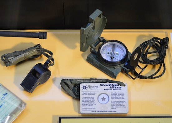 "DAYTON, Ohio -- The ""Duty First, Always Ready"" exhibit, located in the Cold War Gallery at the National Museum of the U.S. Air Force, highlights the service of Senior Airmen Michael Malarsie and Bradley Smith, a two-man Joint Terminal Attack Controller (JTAC) who deployed together to Afghanistan in December 2009. Here are the compass, whistle and signal mirror used by Senior Airman Smith. (U.S. Air Force photo)"