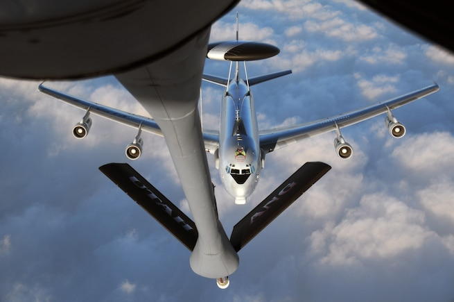 A NATO E-3A AWACS aircraft approaches a Utah Air National Guard KC-135R Stratotanker for air refueling during a training flight over Germany on Jan. 13, 2015. (Air National Guard photo by, Staff Sgt. Annie Edwards/RELEASED)