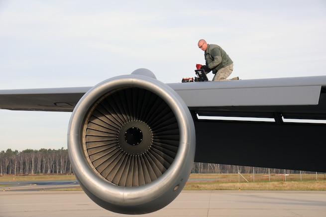 Senior Airman Josh Wasden, a crew chief with the 151st Maintenance Group, adds hydraulic fluid to a KC-135R Stratotanker on Jan. 6, 2015. (Air National Guard photo by Staff Sgt. Annie Edwards/RELEASED)
