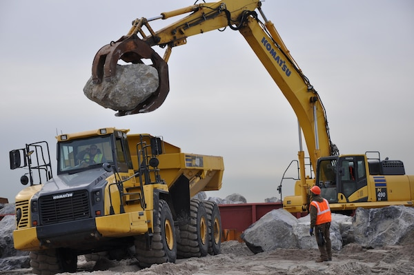 Contractors working for the U.S. Army Corps of Engineers move stone that is being delivered to the Sea Gate work site in Brooklyn January 21, 2015. The work at Sea Gate is an improvement upon the larger Coney Island Coastal Storm Risk Management Project and involves the construction of four stone T-groins, a stone spur on the West 37th Street Groin and reinforcement of the Norton Point Dike and the West 37th Street Groin. The project also includes the placement of roughly 125,000 cubic yards of sand, which will take place later in construction.