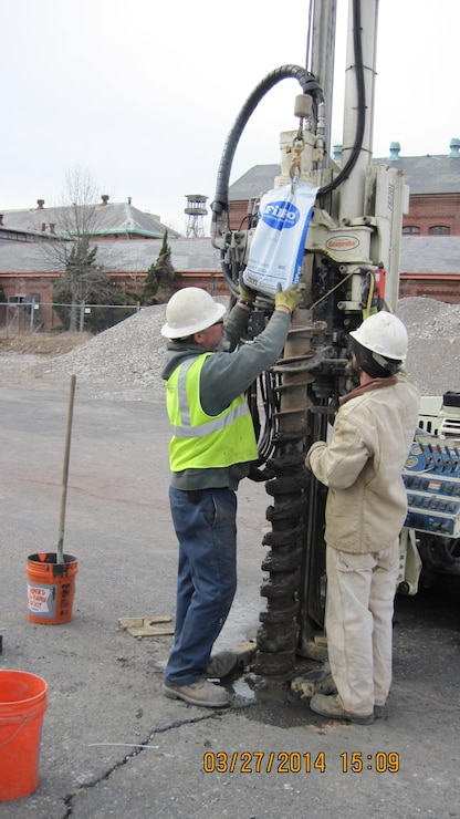 Crews construct a groundwater monitoring well at the Former Frankford Arsenal.