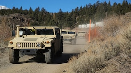 Motor Transport Marines with 2nd Battalion, 6th Marine Regiment, and Combat Logistics Battalion 26, Headquarters Regiment, 2nd Marine Logistics Group, conduct a simulated convoy throughout the hills aboard Bridgeport, California, Jan. 14, 2015. The Marines learned how to operate the High Mobility Multipurpose Wheeled Vehicles and the small unit support vehicles in mountainous terrain during classroom instruction and practical application.