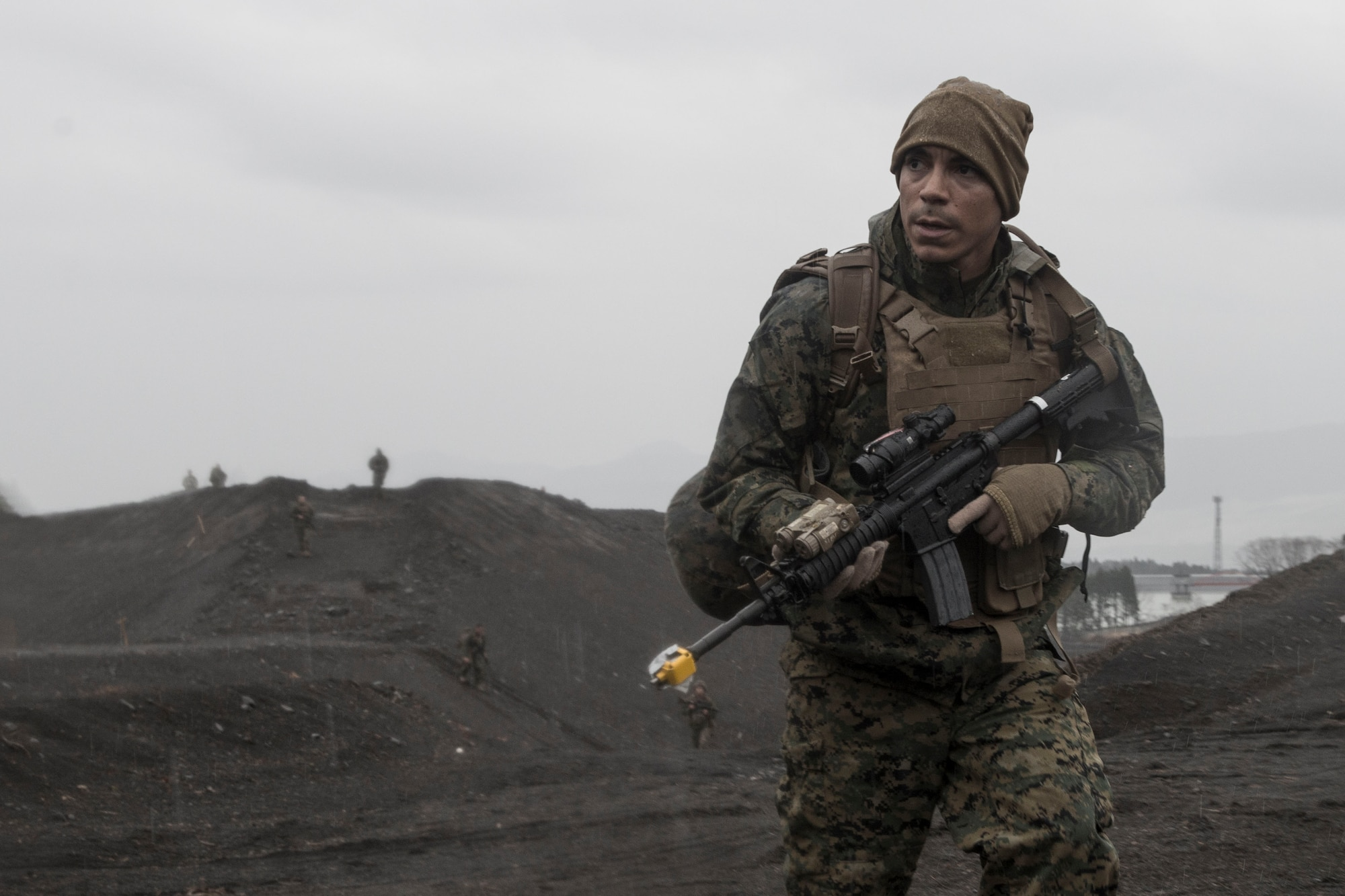 A Marine with the 1st Batallion, 1st Marines, scouts for aircrew during joint training Jan. 16, 2015 at Camp Fuji, Japan. Marines and Sailors acted as enemy aggressors, practicing their patrolling techniques, while searching for Air Force aircrew, who were simultaneously training their survival, evasion, resistance and escape techniques. (U.S. Air Force photo/Staff Sgt. Cody H. Ramirez)
