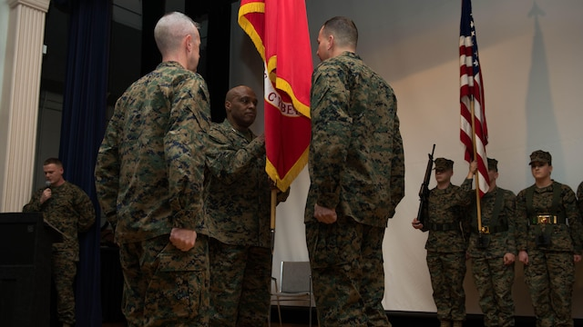 Maj. Gen. Vincent R. Stewart passes the Marine Corps colors Maj. Gen. Daniel J. O'Donohue during a change of command ceremony January 21, 2015 at Fort George G. Meade, Maryland. Stewart relinquished his position as commanding general of Marine Corps Forces Cyberspace to O'Donohue to take the position as director of Defense Intelligence Agency (DIA) and commander of the Joint Functional Component Command for Intelligence, Surveillance and Reconnaissance (JFCC-ISR).