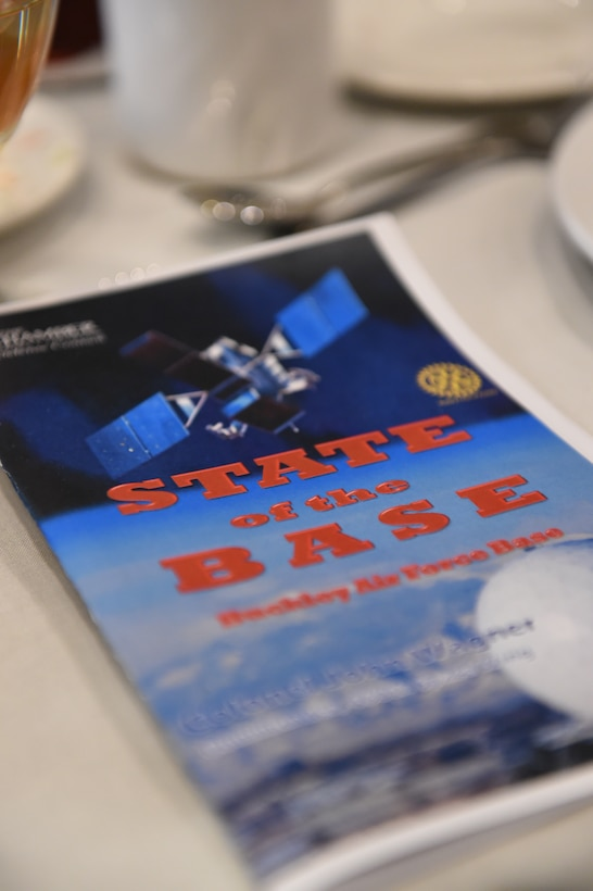 A State of the Base pamphlet is placed on a table during the State of the Base ceremony Jan. 21, 2015, at the DoubleTree by Hilton in Aurora, Colo. During the speech, Col. John Wagner, 460th Space Wing commander, discussed the base's mission and current and upcoming events for Team Buckley, along with the base's economic impact on the community, Aurora Rotary and Aurora Chamber of Commerce. (U.S. Air Force photo by Airman 1st Class Samantha Saulsbury/Released)