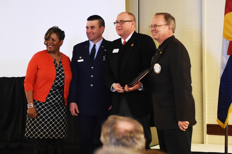 Col. John Wagner, 460th Space Wing commander, stands with community leaders at the State of the Base address Jan. 21, 2015, at the DoubleTree by Hilton in Aurora, Colo. During the speech, Wagner discussed the base's mission and current and upcoming events for Team Buckley, along with the base's economic impact on the community, Aurora Rotary and Aurora Chamber of Commerce. (U.S. Air Force photo by Airman 1st Class Samantha Saulsbury/Released)