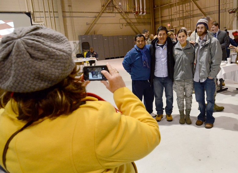 Senior Airman Marvelly Fuentes poses with family as her mom snaps a photo of them at the deployment send-off, Jan. 8, 2015 at Dobbins Air Reserve Base, Ga.  (U.S. Air Force photo/Brad Fallin)