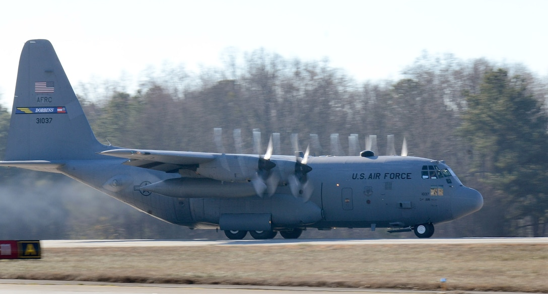 The 94th Airlift Wing C-130H3 beats the moisture out of the air as it accelerates down the Dobbins runway on its way to Southwest Asia; Dobbins Air Reserve Base, Ga., Jan. 8, 2015. (U.S. Air Force photo/Brad Fallin)