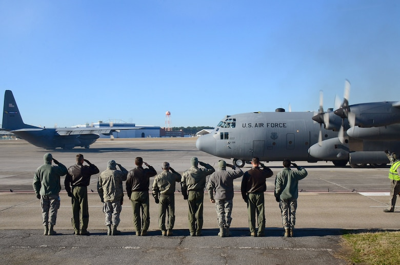 Dobbins Air Reserve Base leadership salutes the second aircrew as the 94th Airlift Wing Hercules begins to taxi out for takeoff to Southwest Asia, at Dobbins Air Reserve Base, Ga., Jan. 8, 2015. (U.S. Air Force photo/Brad Fallin)