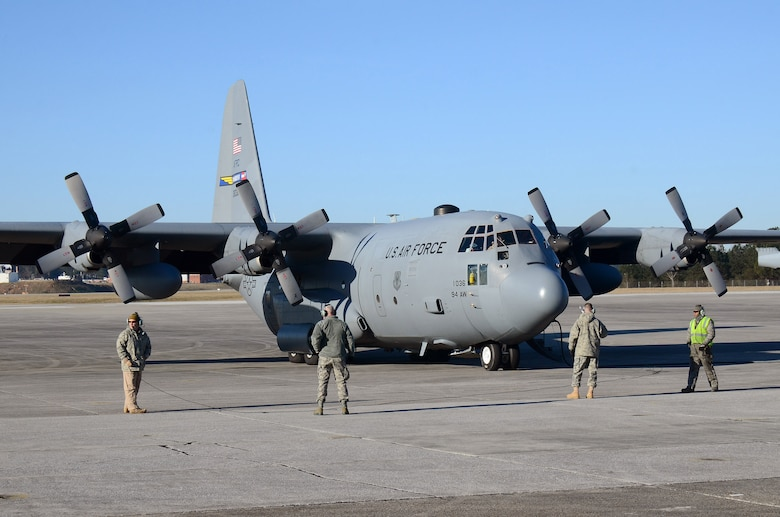94th Airlift Wing maintenance personnel stand by to monitor engines start for the C-130H aircraft. The aircraft is being readied for deployment to Southwest Asia, Jan. 8, 2015 at Dobbins Air Reserve Base, Ga.  (U.S. Air Force photo/Brad Fallin)