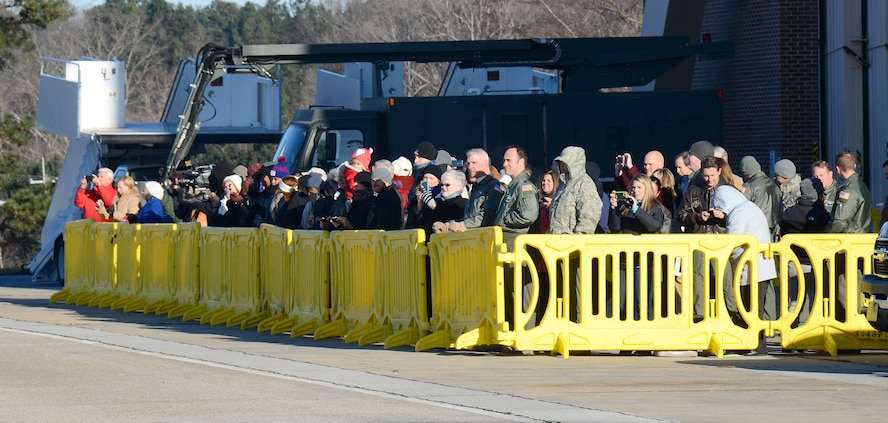 Family and friends assemble to watch 94th Airlift Wing personnel depart on their deployment to Southwest Asia, at Dobbins Air Reserve Base, Ga., Jan. 8, 2015. (U.S. Air Force photo/Brad Fallin)