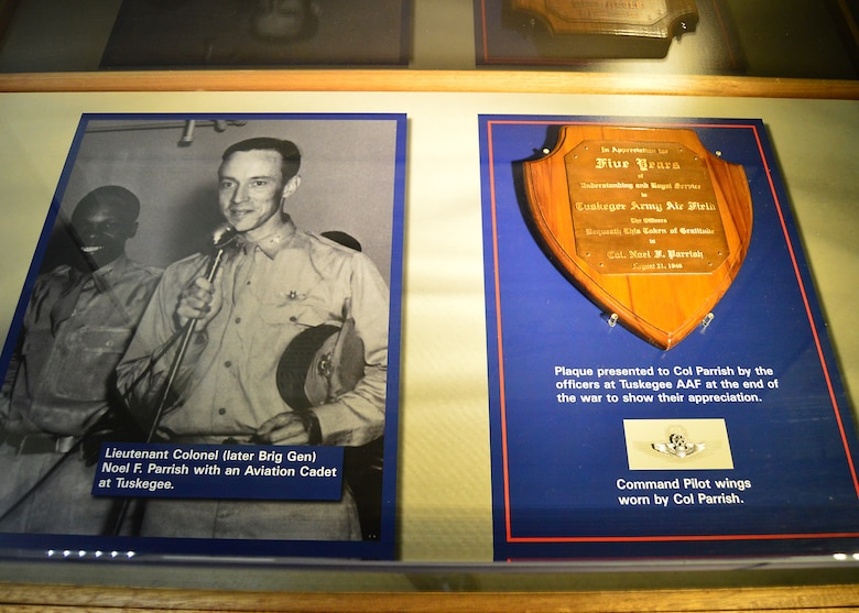 DAYTON, Ohio -- Lieutenant Colonel (later Brig Gen) Noel F. Parrish with an Aviation Cadet at Tuskegee. Also on display are his Command Pilot wings, and a plaque presented to Col Parrish by the officers at Tuskegee AAF at the end of the war to show their appreciation. This display is located in the Tuskegee Airmen Exhibit in the WWII Gallery at the National Museum of the U.S. Air Force. (U.S. Air Force photo)