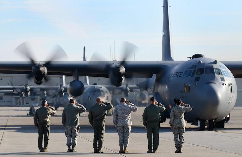 Dobbins Air Reserve Base leadership salutes the aircrew as the 94th Airlift Wing Hercules begins to taxi out for takeoff to Southwest Asia, Jan. 5, 2015. (U.S. Air Force photo/Brad Fallin)