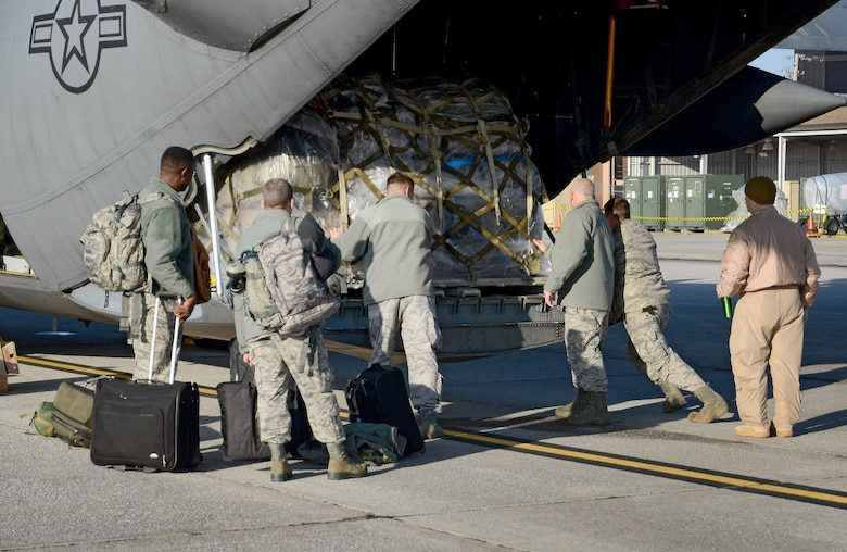 Deploying members of the 94th Airlift Wing make adjustments to the final cargo pallet's location on the loading ramp in preparation for their Southwest Asia deployment, Jan. 5, 2015 at Dobbins Air Reserve Base, Ga.  (U.S. Air Force photo/Brad Fallin)
