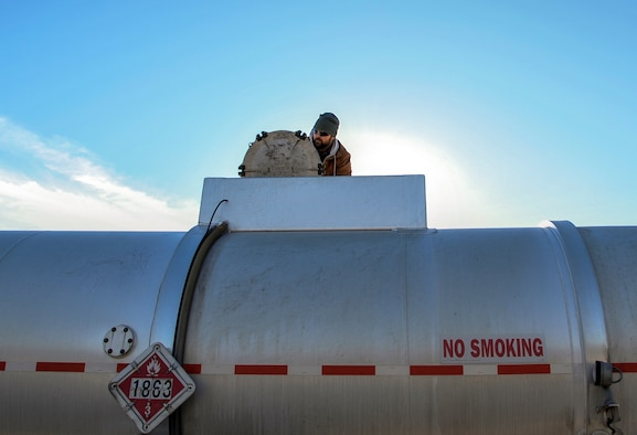 Ernie Gilmore, a 19th Logistics Readiness Squadron fuels distribution system operator, inspects a tanker truck shipment of jet fuel  Jan. 5, 2015, at Little Rock Air Force Base, Ark. Terminal technicians inspect arriving fuel tanks to ensure proper levels and look for any debris or water. (U.S. Air Force photo by Airman 1st Class Harry Brexel)