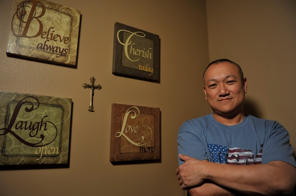 Chief Master Sgt. Jimmy Ku, a 19th Maintenance Group superintendent, at Little Rock Air Force Base, Ark., is a 15-year-cancer survivor and currently lives in Cabot, Ark. Ku found resilience during the darkest parts of his life from a 3-year-old girl, also suffering from cancer, who just wanted to play. (U.S. Air Force photo by Senior Airman Regina Edwards)