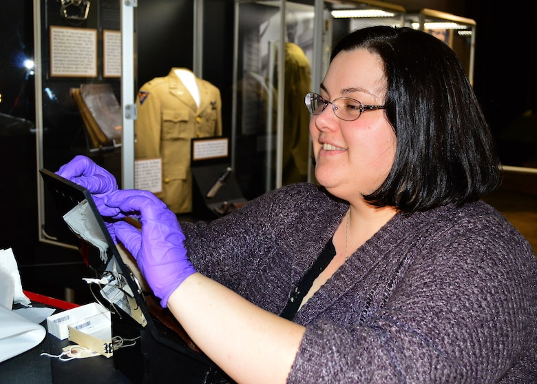 DAYTON, Ohio -- Museum Curator Jennifer Myers works on items in the Tuskegee Airmen Exhibit  in the WWII Gallery at the National Museum of the U.S. Air Force.(U.S. Air Force photo)