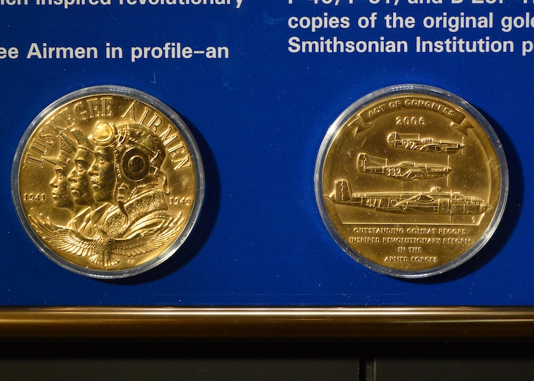 DAYTON, Ohio -- The Tuskegee Airmen Congressional Gold Medal display in the WWII Gallery at the National Museum of the U.S. Air Force. In April 2006, the U.S. Congress voted to award the Tuskegee Airmen a Congressional Gold Medal, the most prestigious award Congress can give to civilians. (U.S. Air Force photo)