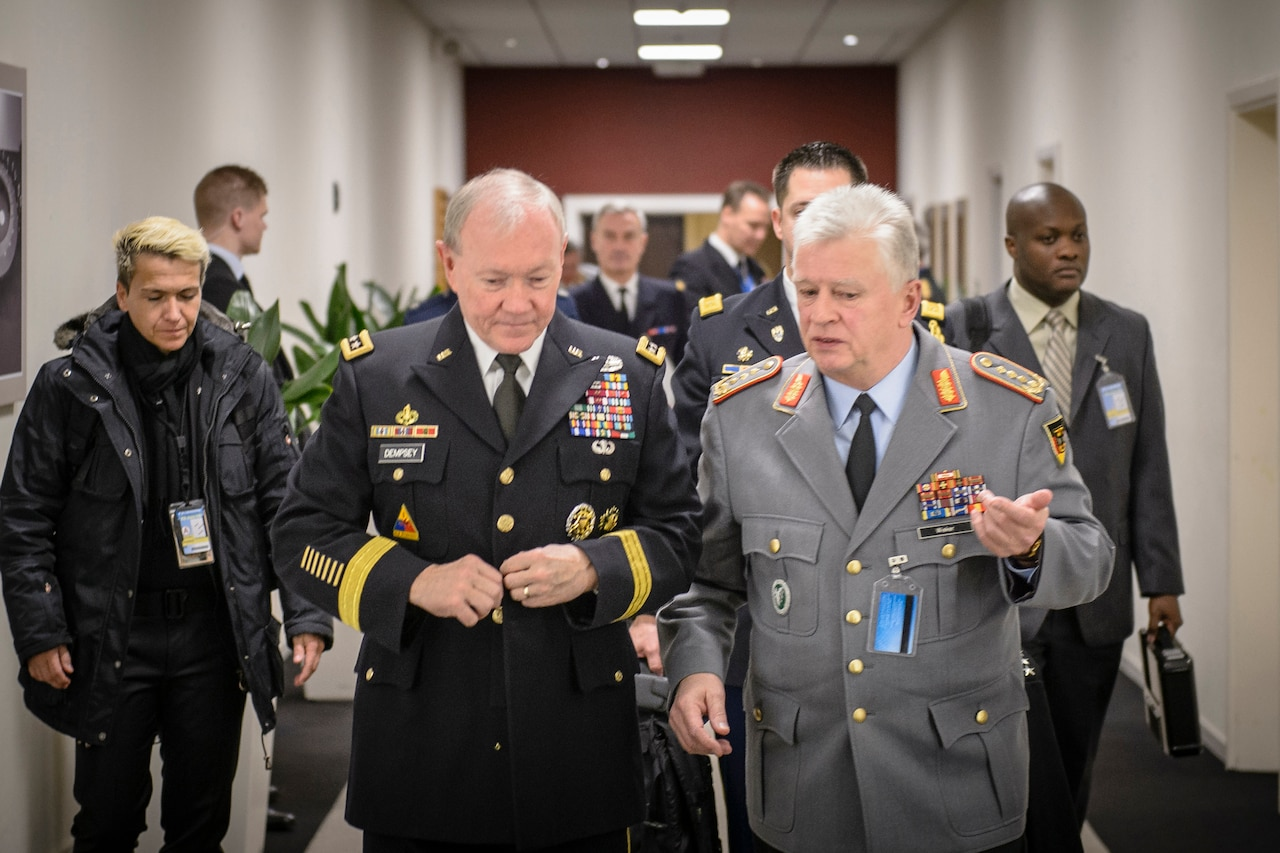 Army Gen. Martin E. Dempsey, left, chairman of the Joint Chiefs of Staff, and German Chief of Defense Army Gen. Volker Wieker talk between NATO's Military Committee conference and the chiefs of defense quarterly meeting in Brussels, Jan. 21, 2015. DoD photo by D. Myles Cullen