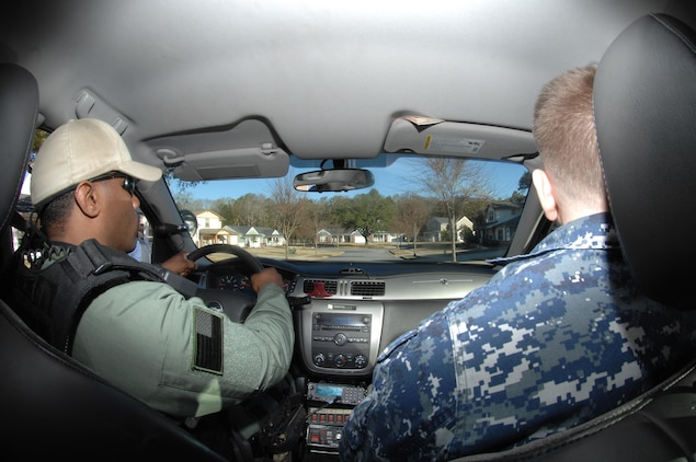 Cpl. Jeremiah Fenn, (left) patrolman, Marine Corps Police Department, Marine Corps Logistics Base Albany, and Petty Officer 2nd Class Joshua Gulley, master at arms, Naval Branch Health Clinic Albany,  patrol the enlisted housing area during a recent security augmentation force monthly training session, here.